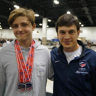 Ethan Kushnerik 7th Cadets with Coach Mokretsov at Junior Olympics 2019